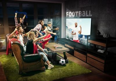 Friends watching football goal