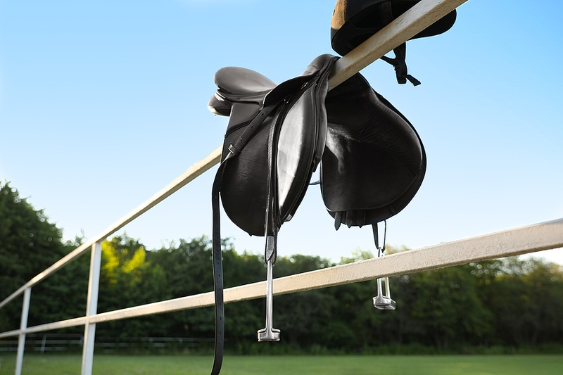 Horse Saddle and Riders Helmet