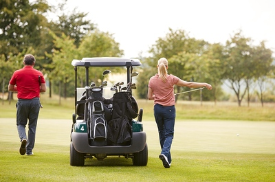 Man Woman Golf Buggy